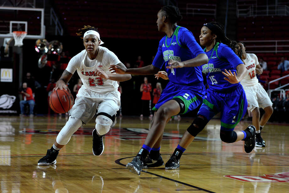 Lamar guard Moe Kinard drives for a layup during the third quarter of a women's basketball game against Texas A&M-Corpus Christi at the Montagne Center on Wednesday evening.  Photo taken Wednesday 1/25/17 Ryan Pelham/The Enterprise Photo: Ryan Pelham / ©2017 The Beaumont Enterprise/Ryan Pelham