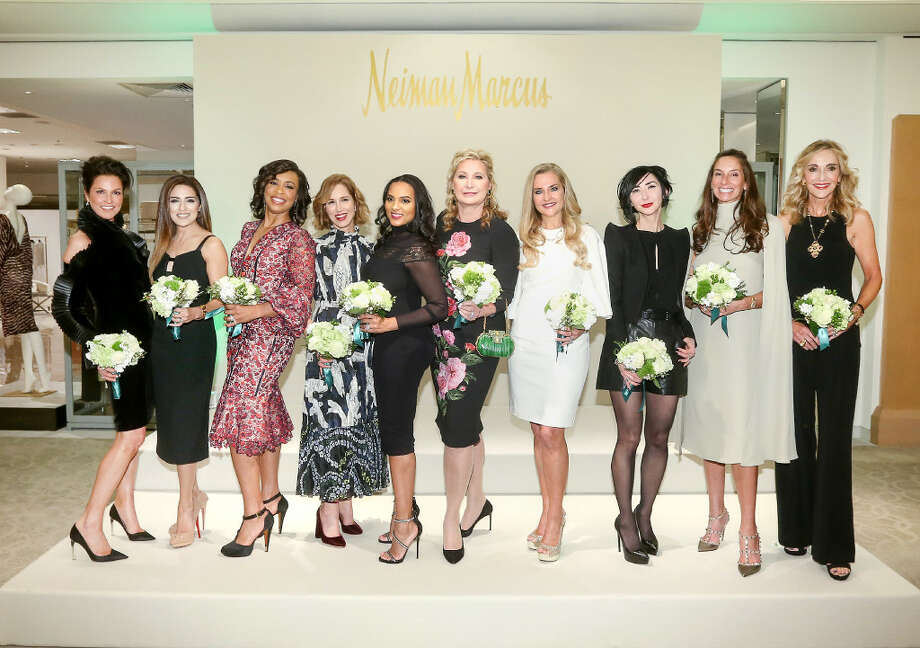 Houston Chronicle's Best Dressed honorees, from left, Jessica Rossman, Sneha Merchant, Gina Gaston Elie, Carolyn Dorros, Clerenda McGrady, Carol Linn, Mary D'Andrea, Carrie Brandsberg-Dahl, Lisa Holthouse and Jana Arnoldy pose for a photo at the Best Dressed Announcement Party at Neiman Marcus in the Galleria, Wednesday, Jan. 25, 2017. ( Jon Shapley / Houston Chronicle) Photo: Jon Shapley