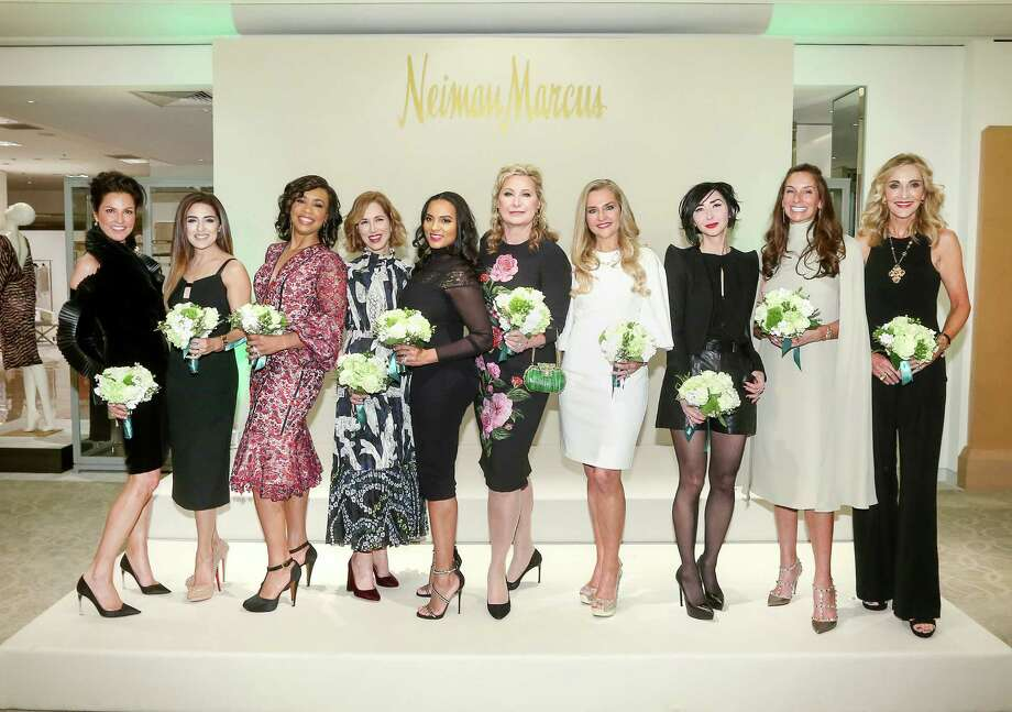 Houston Chronicle's Best Dressed honorees, from left, Jessica Rossman, Sneha Merchant, Gina Gaston Elie, Carolyn Dorros, Clerenda McGrady, Carol Linn, Mary D'Andrea, Carrie Brandsberg-Dahl, Lisa Holthouse and Jana Arnoldy pose for a photo at the Best Dressed Announcement Party at Neiman Marcus in the Galleria, Wednesday, Jan. 25, 2017, in Houston. ( Jon Shapley / Houston Chronicle ) Photo: Jon Shapley, Staff / © 2017  Houston Chronicle