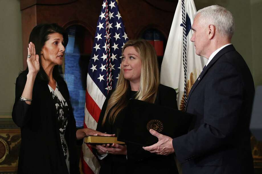 Former South Carolina Gov. Nikki Haley, left, is sworn in Wednesday as the U.S. ambassador to the United Nations by Vice President Mike Pence. Haley's staff member Rebecca Schimsa watches. Photo: Win McNamee / © 2017 Bloomberg Finance LP