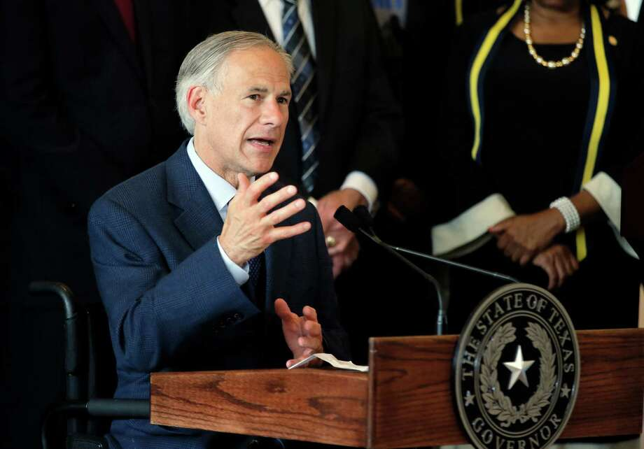 FILE - In this Friday, July 8, 2016 file photo, Texas Gov. Greg Abbott, right, responds to questions during a news conference at City Hall in Dallas. Abbott says he'll work with top conservatives to try to remove from office sheriffs across his state who refuse to enforce federal immigration law. It's the latest sign that Abbott is moving hard to the right and more closely tracking the new Trump administration, which is plotting ways to crackdown on immigration. (AP Photo/Tony Gutierrez, File) Photo: Tony Gutierrez, STF / Copyright 2017 The Associated Press. All rights reserved.