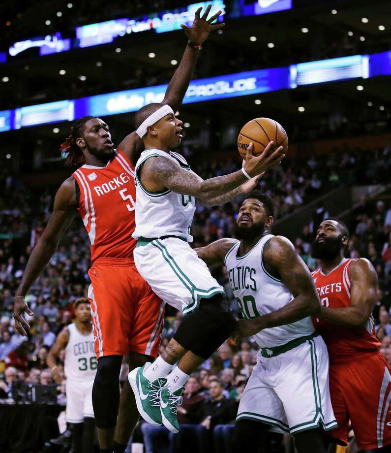 f43ce588770 Boston Celtics guard Isaiah Thomas (4) drives to the basket past Houston  Rockets forward