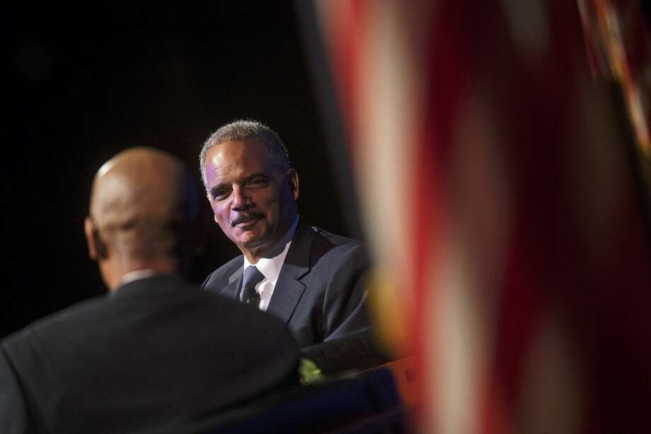 "Former U.S. Attorney General Eric Holder speaks during the Eighth Annual Great Lakes Bay Regional MLK Jr. Celebration on Wednesday at Saginaw Valley State University's Malcolm Field Theatre for Performing Arts. Holder served as the first African-American Attorney General from 2009 to 2015. Guided by Saginaw's Chief Judge Terry L. Clark of the 70th Judicial District Court, Holder talked about his upbringing, his time in the White House and more. As Holder recalls, when President Obama called to offer him the position, he ended the call with ""Let's go make some history."" Photo: Erin Kirkland/Midland Daily News"