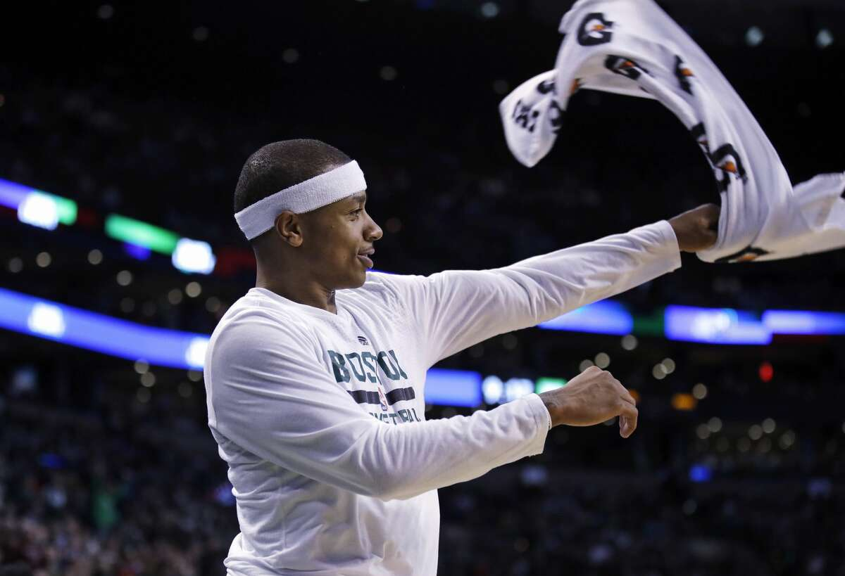 Boston Celtics guard Isaiah Thomas waves a towel as he takes a rest during the second half of an NBA basketball game against the Houston Rockets in Boston, Wednesday, Jan. 25, 2017. Thomas scored 38 points as the Celtics defeated the Rockets 120-109. (AP Photo/Charles Krupa)