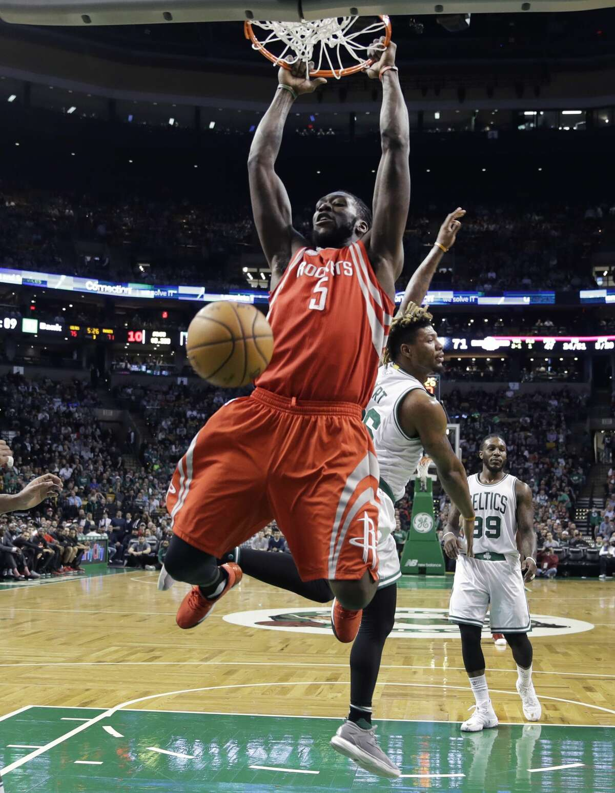 Houston Rockets forward Montrezl Harrell (5) slams a dunk against the Boston Celtics during the second half of an NBA basketball game in Boston, Wednesday, Jan. 25, 2017. The Celtics defeated the Rockets 120-109. (AP Photo/Charles Krupa)