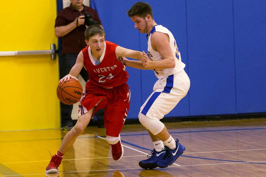 Beaverton's Mason Oldani controls the ball while being defended by Harrison's Reed Romanowski in a game at Harrison High School on Wednesday. Photo: Theophil Syslo For The Daily News
