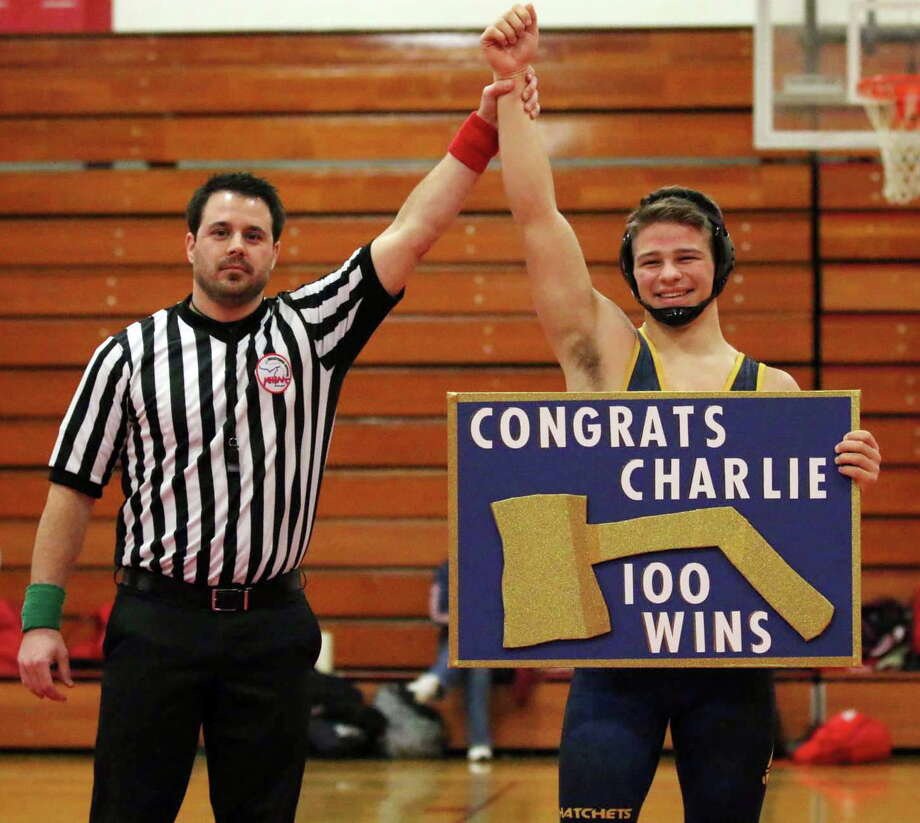 Bad Axe wrestler Charlie Hass poses after securing his 100th career victory, Wednesday night, in Marlette. Photo Courtesy of Bad Axe Grapplers