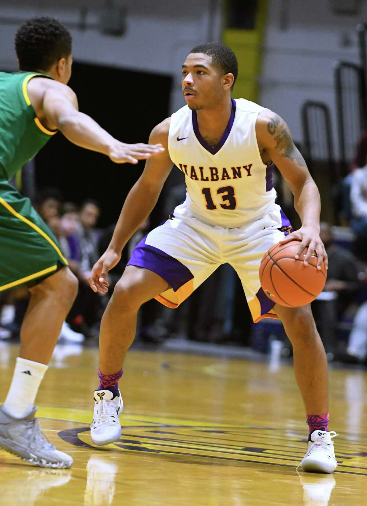 University at Albany's David Nichols brings the ball up the court during a basketball game against Vermont at the SEFCU Arena on Wednesday, Jan. 25, 2017 in Albany, N.Y. (Lori Van Buren / Times Union)