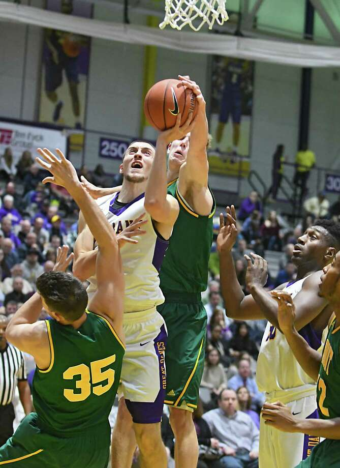 University at Albany's Joe Cremo drives to the basket during a basketball game against Vermont at the SEFCU Arena on Wednesday, Jan. 25, 2017 in Albany, N.Y. (Lori Van Buren / Times Union) Photo: Lori Van Buren / 20039504A