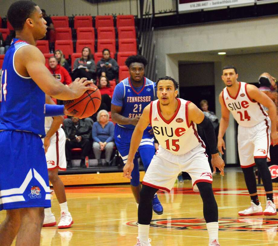 SIUE's Josh White, right, plays defense during the first half against the Tigers.