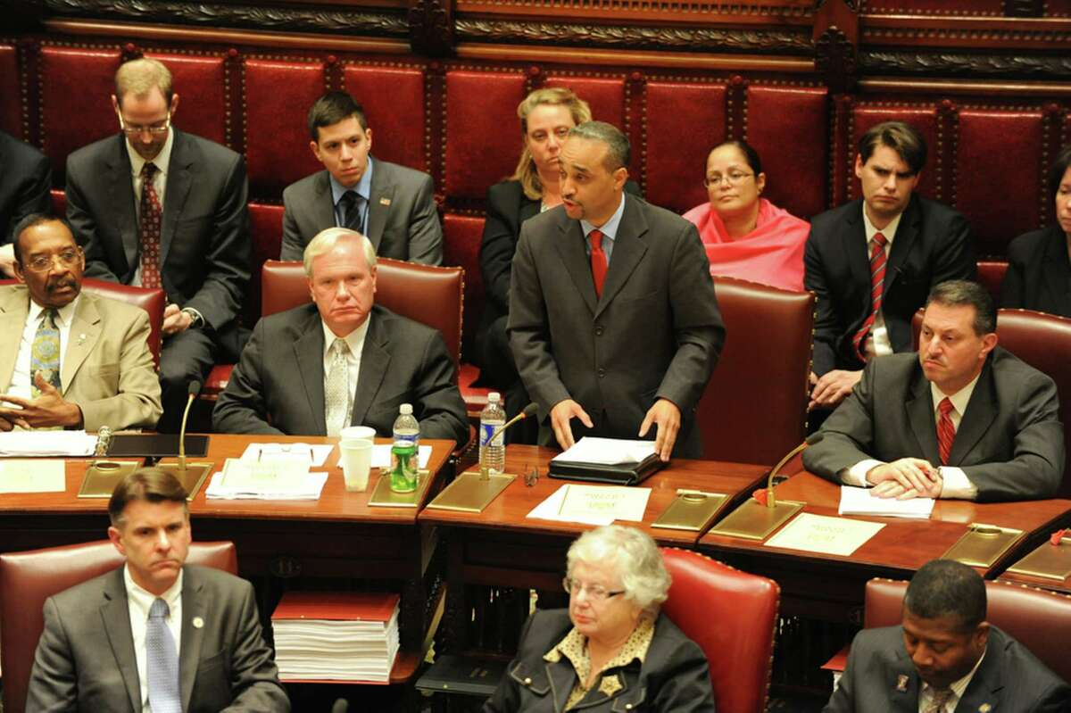 Sen. Jose Peralta stands up and speaks in favor of Gov. Andrew Cuomo's gun control bill during the senate vote at the Capitol on Monday Dec. 14, 2013, in Albany, N.Y. Sen. Peralta is joining the Senate Independent Democratic Conference. (Lori Van Buren/Times Union)