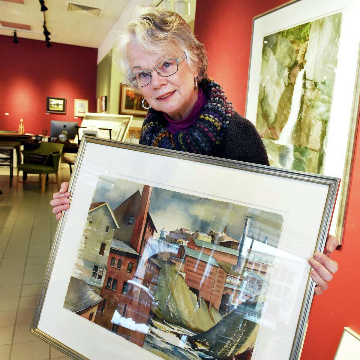Deane Semerad Pfeil of Saratoga Springs prepares a retrospective art show of her late mother, Marjorie Semerad, a popular Russell Sage College art professor, at Clements Art Tuesday Jan. 24, 2017 in Troy, NY. The show opens on Troy Night Out. (John Carl D'Annibale / Times Union)