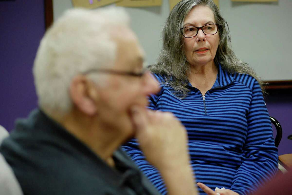 Ron Bruso, left, of Loudonville, who has Alzheimer's, listens as his wife Barb Bruso talks about Alzheimer's during an interview on Wednesday, Jan. 25, 2017, at the Alzheimer's Association in Albany, N.Y. (Paul Buckowski / Times Union)