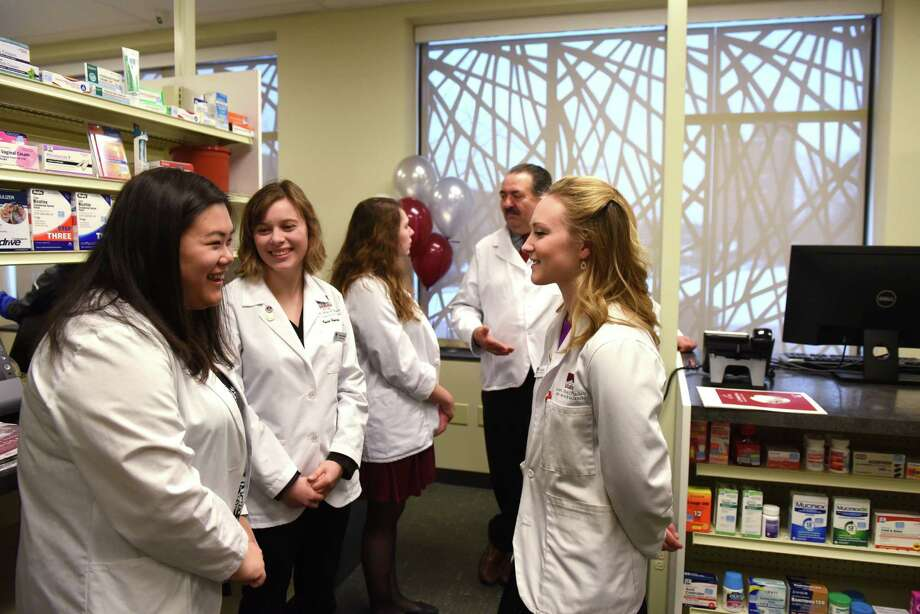 Rebecca Chu of Queens, left, Alyssa Hopsicker of Guilderland, center, and Kara Olstad of Latham, right, chat following a ribbon cutting ceremony to open College Parkside Pharmacy, Albany College of Pharmacy and Health Sciences' (ACPHS) second student-operated pharmacy, on Wednesday, Jan. 25, 2017, at Capital South Campus Center in Albany, N.Y. (Will Waldron/Times Union) Photo: Will Waldron / 20039524A