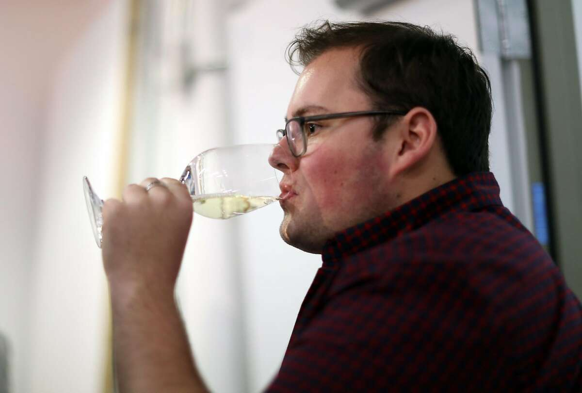 Foot of the Bed Cellars' wine club member Travis Seville during wine pick up party in San Francisco, Calif., on Wednesday, January 25, 2017.