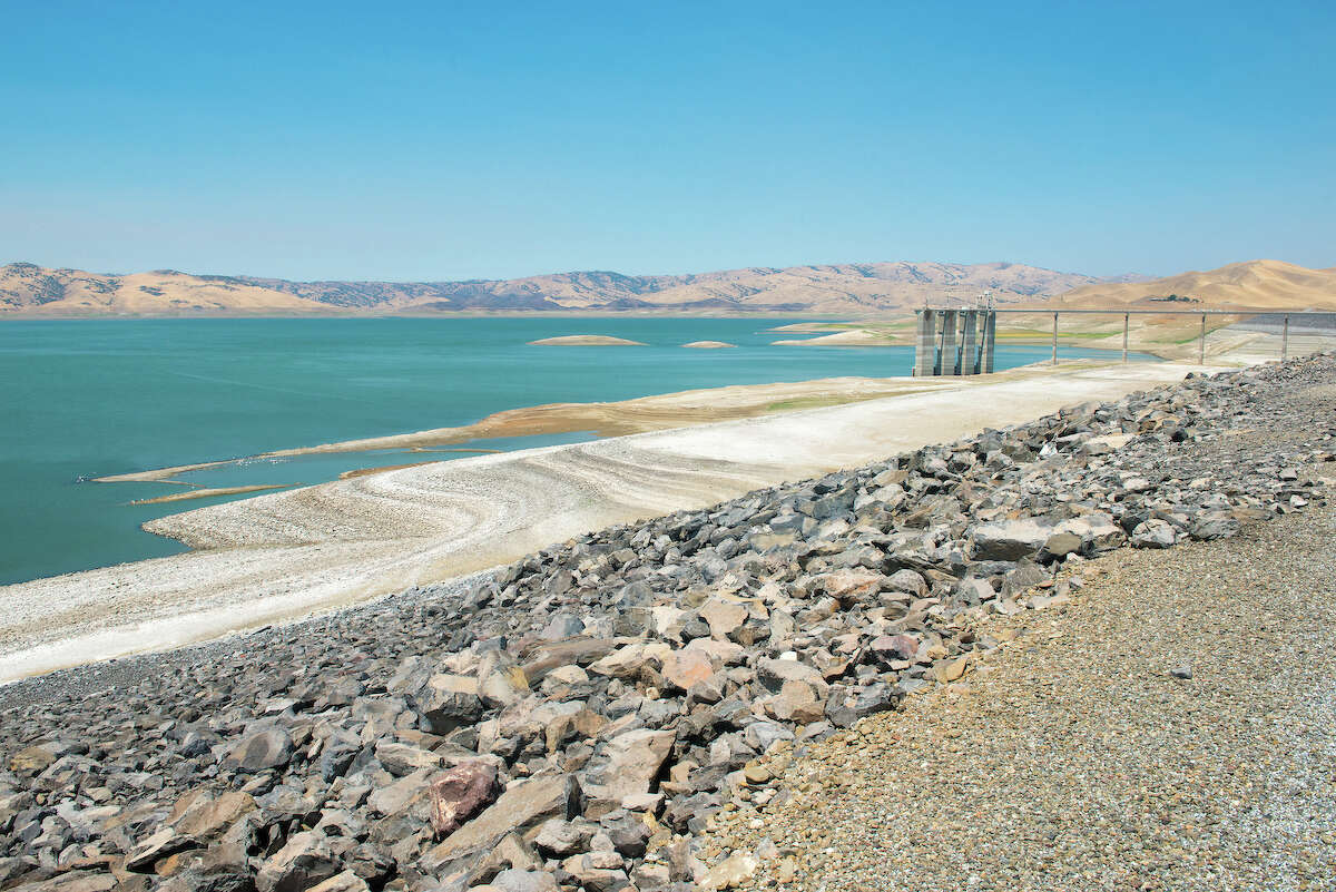 San Luis Reservoir is part of the larger San Luis Reservoir State Recreation Area in Gustine, Calif., July 28, 2016. On this date, the water storage was 199,386 acre feet, 10% of total capacity, and 19% of historical average. San Luis Reservoir, impounded by Sisk Dam, lies at the base of the foothills on the west side of the San Joaquin Valley in Merced County, about 2 miles west of O'Neill Forebay. Florence Low / California Department of Water Resources