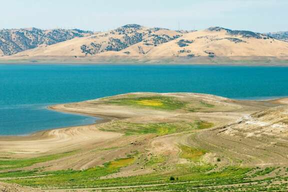Left:  San Luis Reservoir at 10 percent of total capacity on July 28, 2016. 