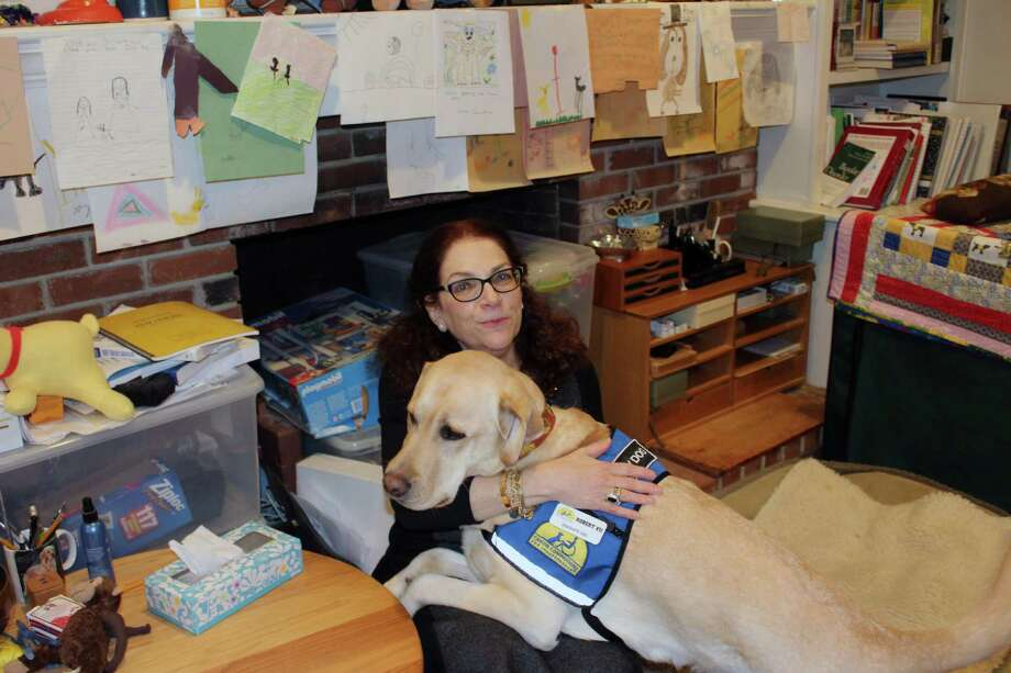 Dr. Nancie Spector with facility dog Robert in Spector's home office in New Canaan. Photo: Justin Papp / Hearst Connecticut Media / New Canaan News
