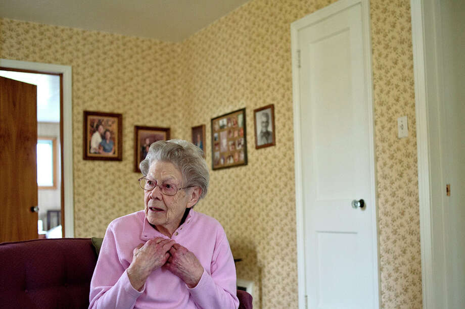 NICK KING | nking@mdn.net  Soon to be 100 years old,  Frieda Milano talks about her life and the changes she's seen in the city over the years on Monday in the living room of her Midland home. / Midland Daily News
