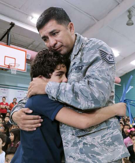 Muller Elementary student Alveyen Alfaro is embraced by his father, Air Force Sgt. Jose Alfaro, on Wednesday, Jan. 25, 2017, at the school gymnasium where Alfaro made a surprise entrance for his son after a seven-month military deployment. Photo: Cuate Santos /Laredo Morning Times / Laredo Morning Times