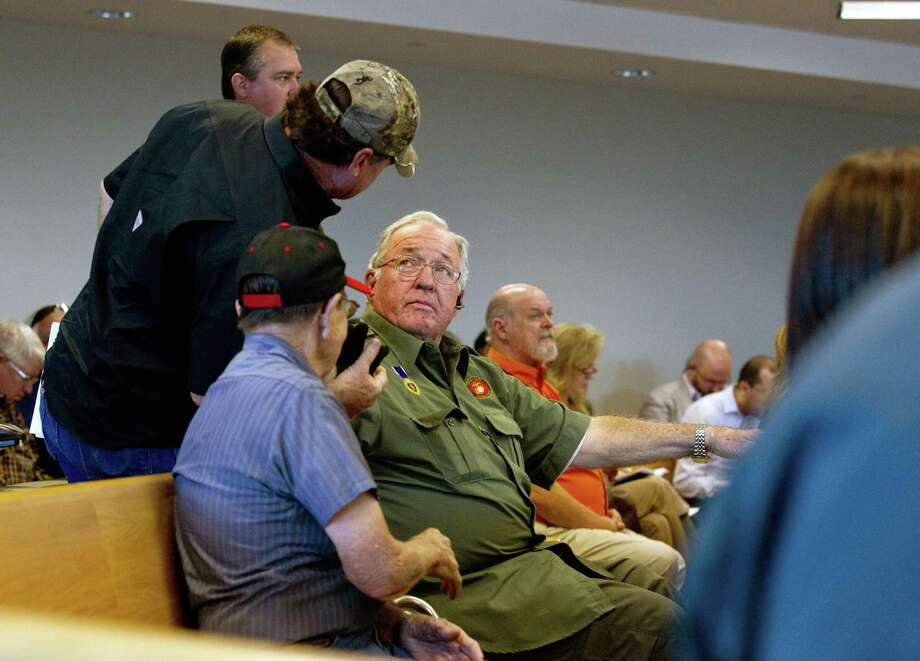 Retired United States Marine Corps Cpl. Jimmie Edwards III, center, is seen after presenting a plan to relocate Montgomery County War Memorial Park during a Montgomery County Commissioners Court meeting Tuesday, Jan. 24, 2017, in Conroe. The court voted to allow Edwards to continue plans to decommission the park and relocate it to a site yet to be determined. Photo: Jason Fochtman, Staff Photographer / Houston Chronicle / Houston Chronicle