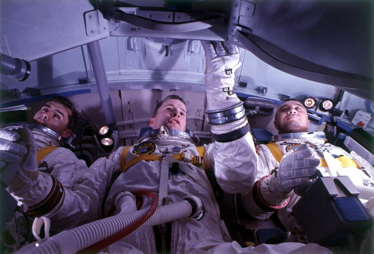 Crew of the Apollo 1 Mission doing tests in the simulator, from the l: Edward Higgins White, Roger B. Chaffee, and Gus Grissom.