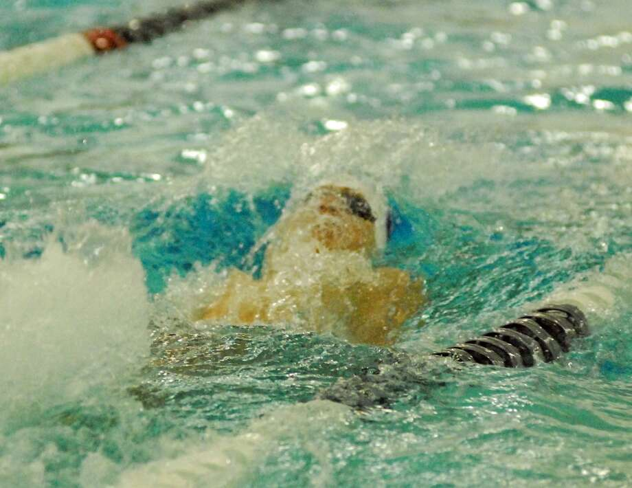 Staples' Austin Twiss swims in the 100 backstroke during a meet against Darien on Wednesday. Photo: Ryan Lacey / Hearst Connecticut Media