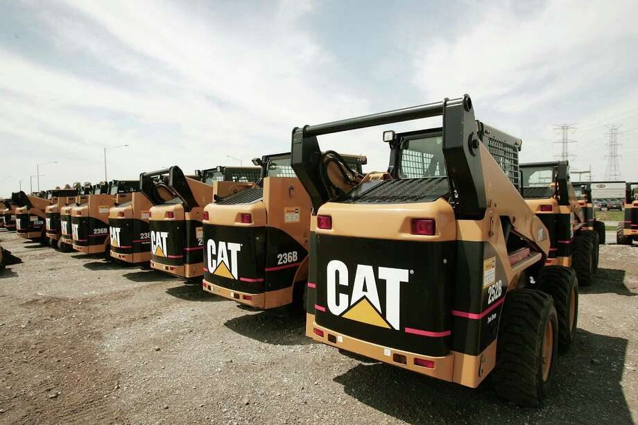 Caterpillar forecast 2017 revenue and earnings that trailed analysts' estimates as signs of a recovery in mining and energy have yet to translate into a rebound in demand for the company's signature yellow machines. Photo: Getty Images /File Photo / 2006 Getty Images