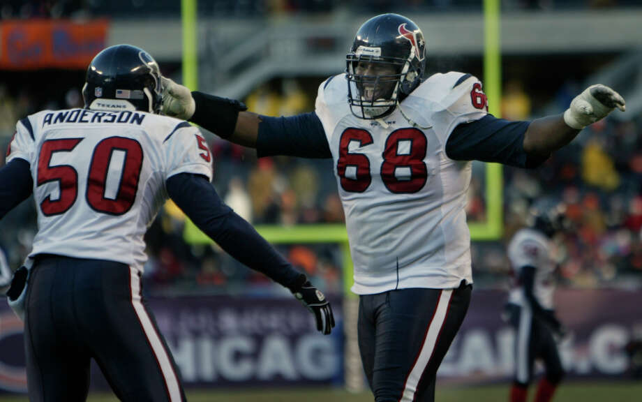 12/19/04--Houston Texans Marcus Spears (#68) congratulates Charlie Anderson (#50) after scoring a fourth-quarter touchdown on a Chicago Bears fumble at Soldier Field Sunday afternoon, Dec. 19, 2004, in Chicago.  The Texans won 24-5.  (Kevin Fujii/Chronicle) Photo: Kevin Fujii, Houston Chronicle / Houston Chronicle