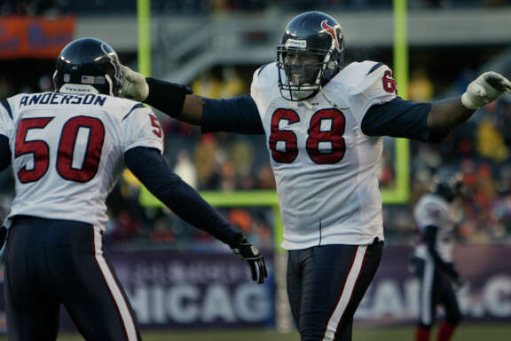 12/19/04--Houston Texans Marcus Spears (#68) congratulates Charlie Anderson (#50) after scoring a fourth-quarter touchdown on a Chicago Bears fumble at Soldier Field Sunday afternoon, Dec. 19, 2004, in Chicago.  The Texans won 24-5.  (Kevin Fujii/Chronicle)