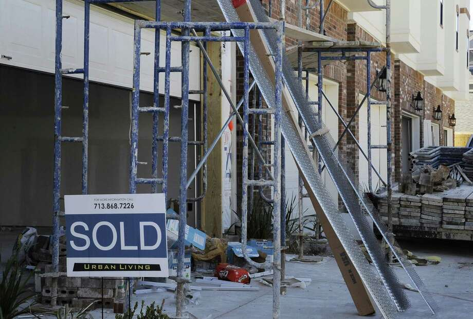 The Commerce Department said new-home sales last month fell 10.4 percent to a seasonally adjusted annual rate 536,000. But sales totaled 563,000 in 2016, up 12.2 percent over the past year. Photo: Associated Press /File Photo / Copyright 2017 The Associated Press. All rights reserved.