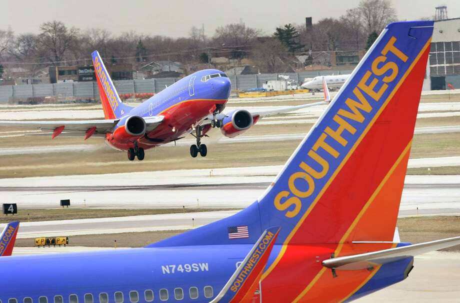 Southwest Airlines exceeded analysts' fourth-quarter profit expectations. Adjusted earnings of 75 cents a share topped the 69-cent average of estimates compiled by Bloomberg. Sales rose 2 percent to $5.08 billion, Southwest said in a statement. Analysts had anticipated $5.03 billion. Photo: Getty Images /File Photo / 2008 Getty Images