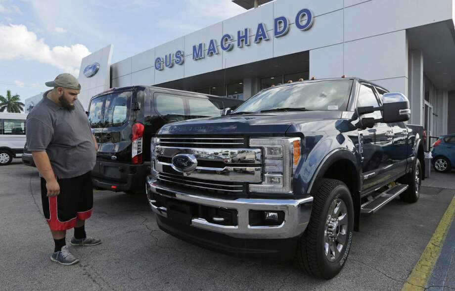 For the fourth quarter, Ford posted a $783 million net loss compared with a $1.9 billion profit a year ago. The loss was due largely to a $3 billion noncash adjustment of pension obligations and a $200 million charge for halting construction of the Mexican factory. Photo: Alan Diaz /Associated Press / Copyright 2017 The Associated Press. All rights reserved.
