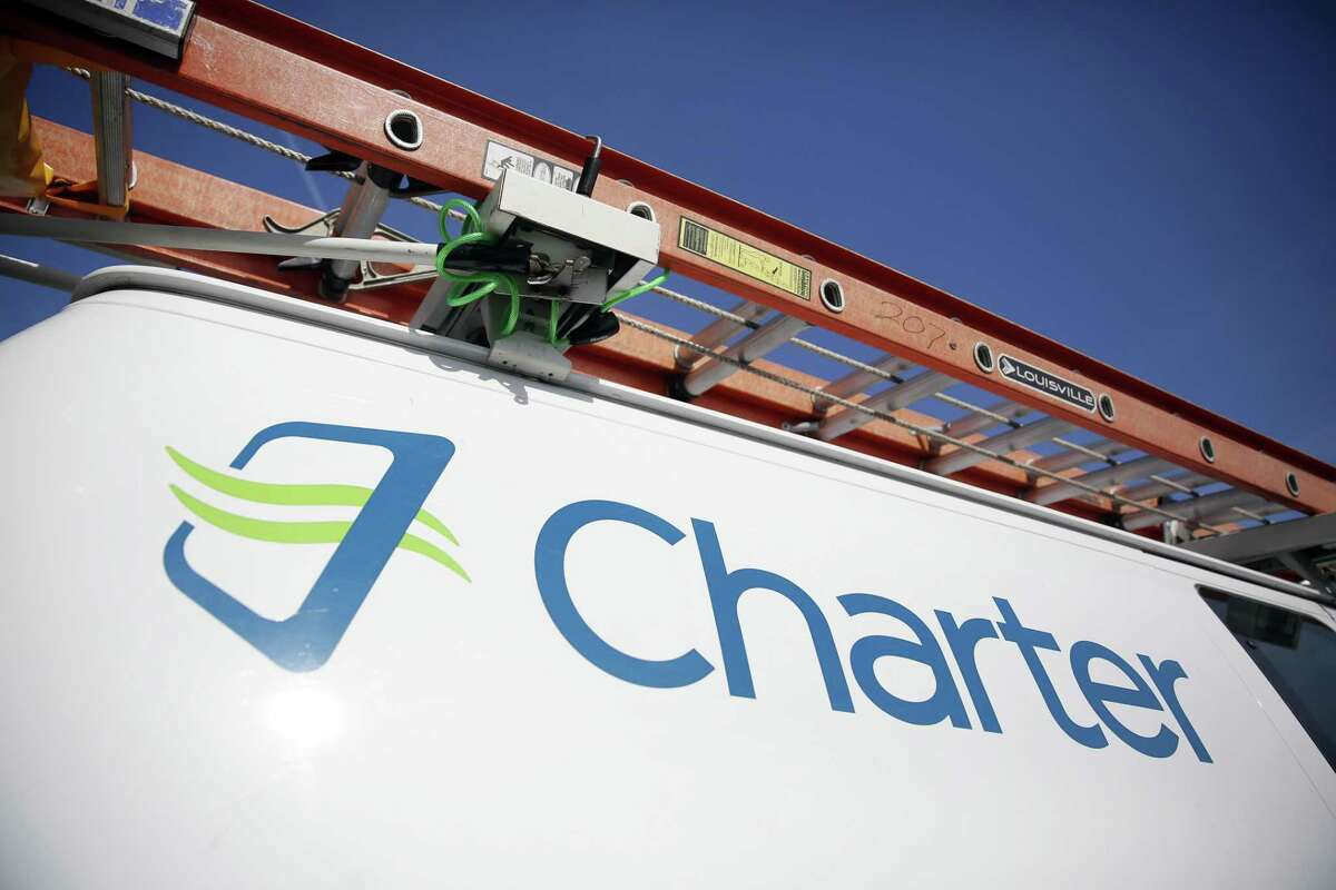 Charter Communications is being sued by a former Spectrum sales exec, who alleges she was terminated from her job in San Antonio in retaliation for reporting securities fraud. Charter is the parent company of Spectrum. Pictured is a Charter Communications truck in 2015.
