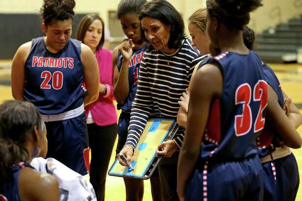 Veterans Memorial High School junior varsity girls basketball coach Christina Camacho draws up a play during the game against Churchill held Friday Jan. 20, 2017 at Churchill High School. Churchill won 47-40.