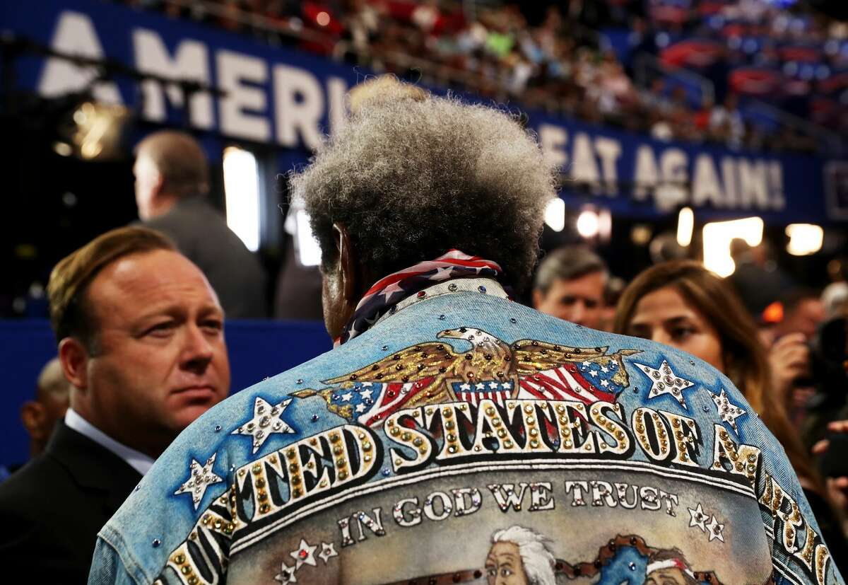 FILE - Boxing promoter Don King speaks with radio show host Alex Jones during the third day of the Republican National Convention on July 20, 2016 at the Quicken Loans Arena in Cleveland.