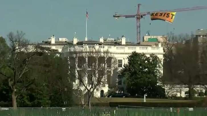 Bay Area residents join Greenpeace protesters in deploying a 70-foot-wide banner near the White House.