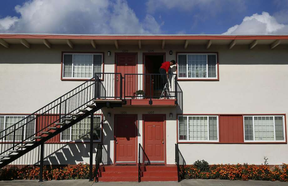 Ezzie Martin, 75, Changes A Lightbulb Outside Of Her Place On The Small  Apartment
