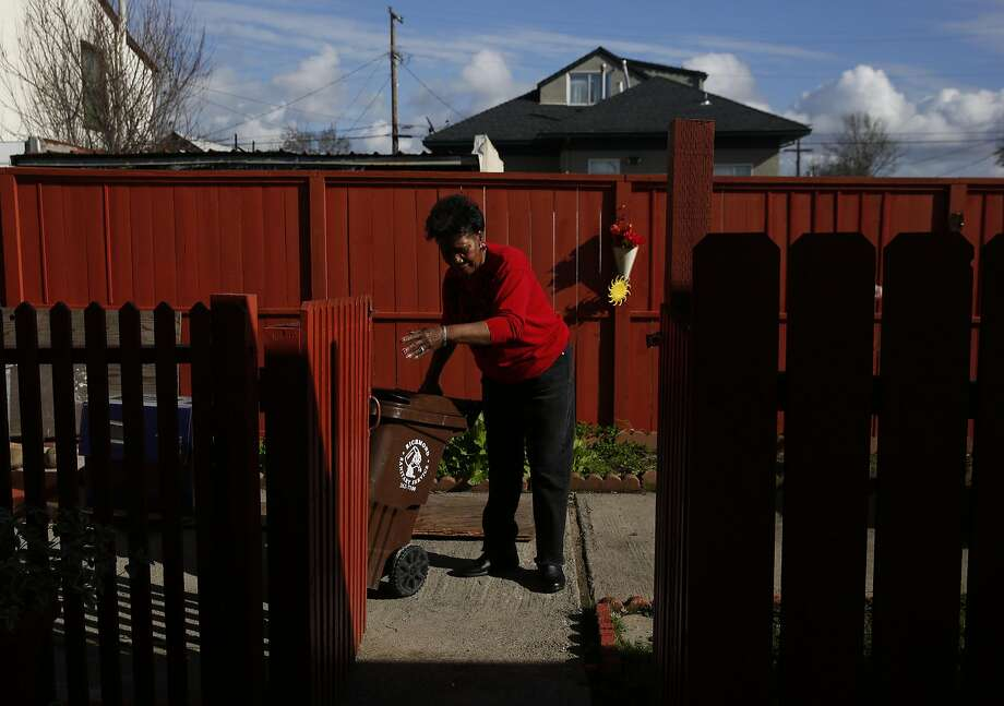 Ezzie Martin, 75, takes out the garbage from the small apartment building she owns and manages Jan. 25, 2017 in Richmond Calif. Photo: Leah Millis, The Chronicle
