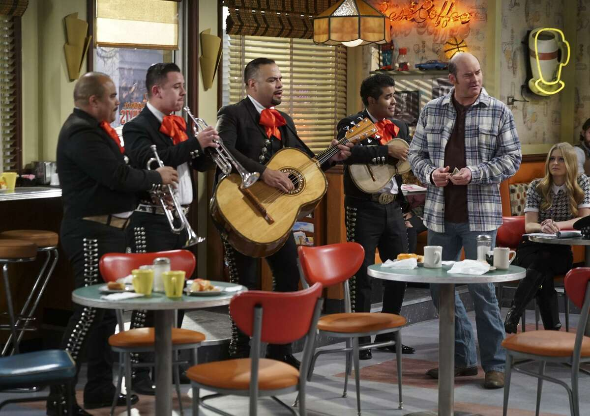 """Above: A mariachi band and Tush (David Koechner) enliven the store in """"Superior Donuts,"""" where Maya (Anna Baryshnikov, right) is about the only regular customer. Left: Katey Sagal plays a cop who stops into the shop when on her beat, and Jermaine Fowler plays Franco, who comes up with new doughnut flavors."""