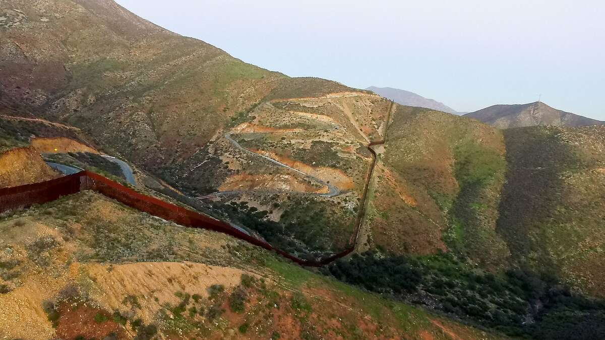 """Aerial view of the border fence between Mexico and the US taken on January 25, 2017 in Tijuana, Mexico. US President Donald Trump on Thursday told Mexico's president to cancel an upcoming visit to Washington if he is unwilling to foot the bill for a border wall. Escalating a cross border war of words, Trump took to Twitter to publicly upbraid Enrique Pena Nieto. """"If Mexico is unwilling to pay for the badly needed wall, then it would be better to cancel the upcoming meeting."""" / AFP PHOTO / MARIO VAZQUEZMARIO VAZQUEZ/AFP/Getty Images"""