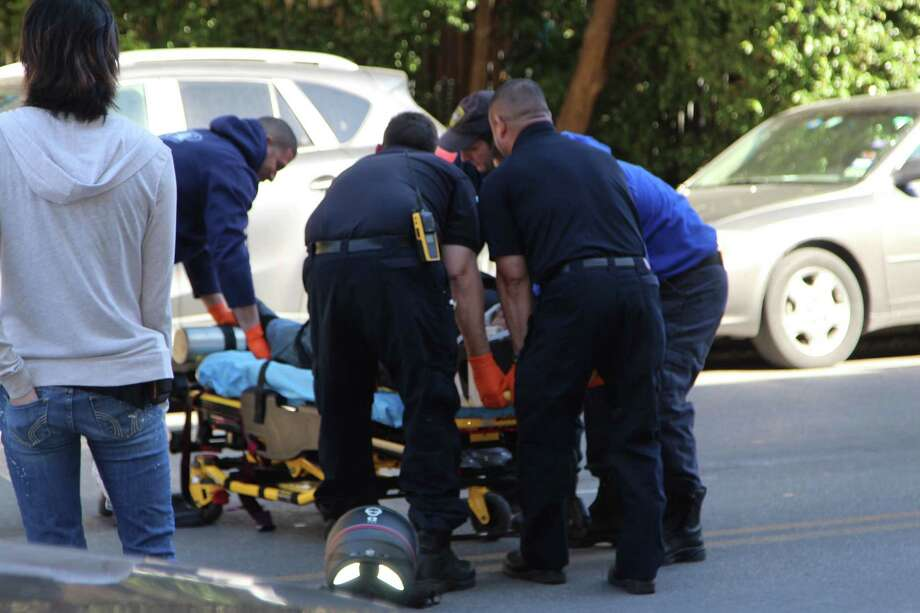 A man was injured Jan. 26, 2017, in downtown San Antonio after losing control of his motorcycle. Photo: Tyler White, San Antonio Express-News / San Antonio Express-News