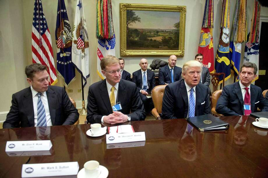 """President Donald Trump meets with business leaders, including Elon Musk (left), Monday in the Roosevelt Room. """"Elon Musk has an important line of communication to Donald Trump,"""" Morgan Stanley analyst Adam Jonas says. """"This strategic relationship between Tesla leadership and the new administration is an important development."""" Photo: Nicholas Kamm /AFP /Getty Images / AFP or licensors"""