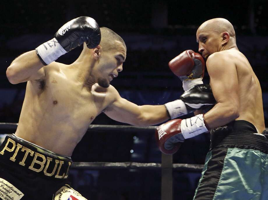 Javier Rodriguez (left) and Alejandro Moreno exchange punches during their super bantamweight bout part of the Premier Boxing Champions card on Dec. 12, 2015 at the AT&T Center. Rodriguez won by unanimous decision. Photo: Edward A. Ornelas /San Antonio Express-News / © 2015 San Antonio Express-News