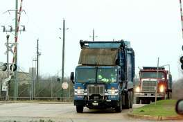 Trucks leave the Blue Ridge Landfill in Fresno, which the Texas Commission on Environmental Quality has identified as the source for an odor that has caused complaints from residents in part of Pearland, including Shadow Creek Ranch.