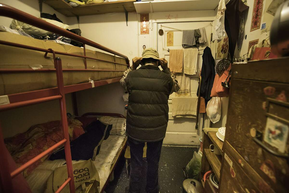 Jin Nuan Huang, 76, puts on his at in his room at 937 Clay Street on Thursday, Jan. 26, 2017 in San Francisco, Calif. He is a plaintiff in the lawsuit. Chinatown Community Development Center is alleging that the owner of a Chinatown CDC (SRO) is harassing long-time residents -- hoping to get them to leave in order to replace them with high rent paying tech workers and students.