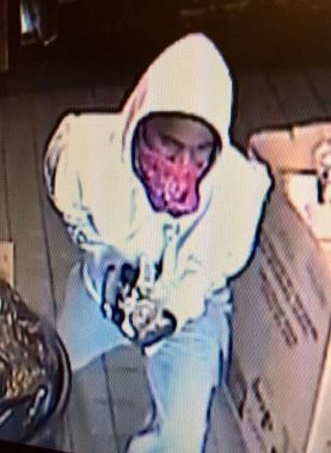 Police are looking for the suspect who robbed a Freddy's Frozen Custard and Steakburgersat gunpoint on Jan. 26, 2017, in the city's North Side. Photo: San Antonio Police Department