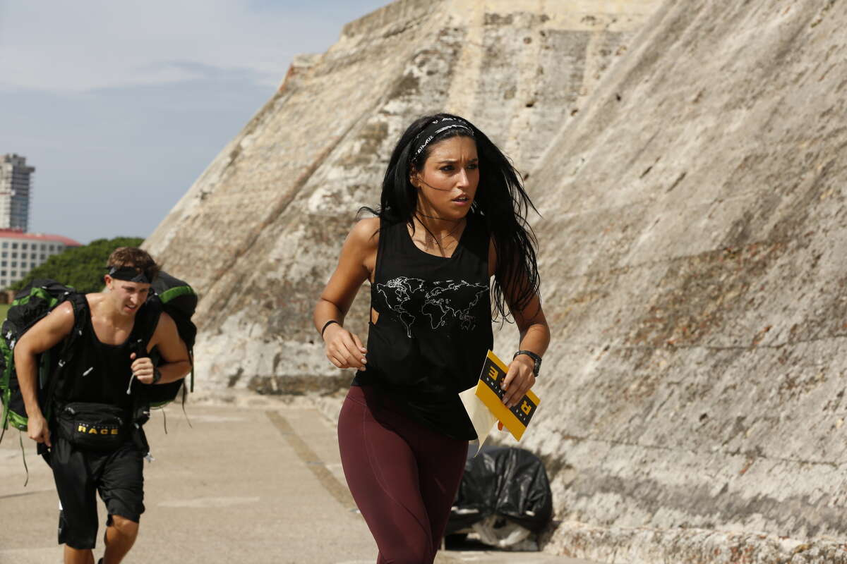 """Matt (left) and Dana (right) must search the catacombs in Cartagena, Colombia for the next clue then choose between 'Tickets' and 'Tejo' on an """"The Amazing Race"""" episode in 2015."""