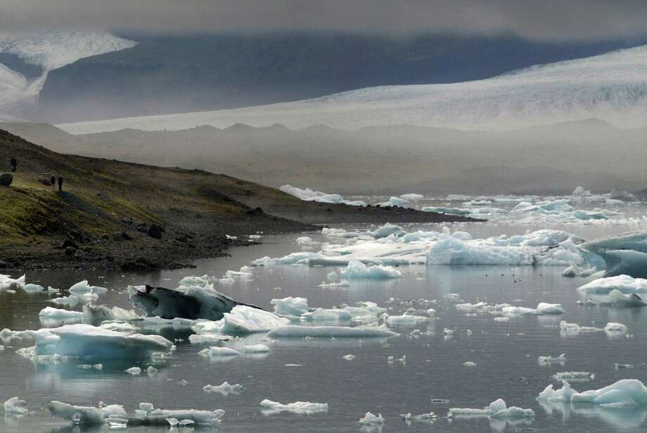 The Earth has just experienced three record years of global warming. That means we could be seeing more images such as this — detaching icebergs in Iceland's Vatnajökull glacier as they move toward the sea in 2006. The melting of Earth's ice and snow is accelerating the effects of global warming and could trigger wider-ranging impacts on people, economies and wildlife. Photo: Marcel Mochet /AFP /Getty Images / 2007 AFP