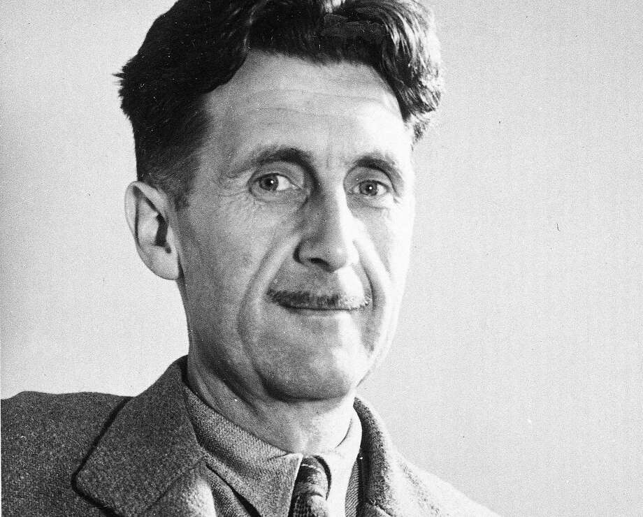 "FILE - In this file photo, writer George Orwell poses in this undated photo at an unknown location. Pearson PLC will merge its Penguin Books division with Random House, which is owned by German media company Bertelsmann, in an all-share deal that will create the world's largest publisher of consumer books, it was reported on Monday, Oct. 29, 2012. The planned joint venture brings together classic and best-selling names. As well as publishing books from authors such as John Grisham, Random House scored a major hit this year with ""Fifty Shades of Grey."" Penguin has a strong backlist, including George Orwell, Jack Kerouac and John Le Carre. (AP Photo, File) Photo: AP"